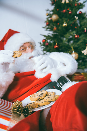 santa claus eating cookies
