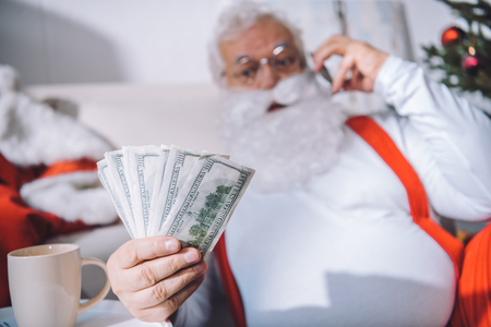 santa claus with cash in hand Stock Photo