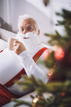 santa claus with cup of coffee Stock Photo