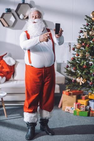 santa claus pointing at smartphone