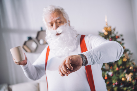 santa claus checking time Stock Photo