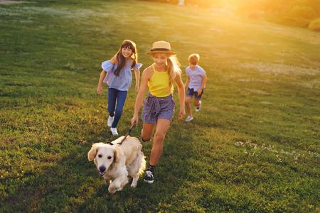 teenagers walking with dog