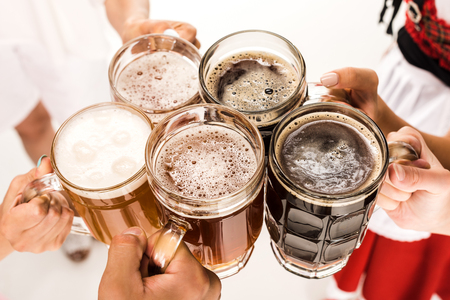 clinking with beer glasses Stock Photo