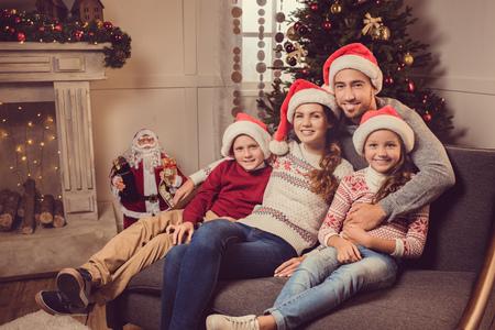 family sofa: family on christmas eve Stock Photo