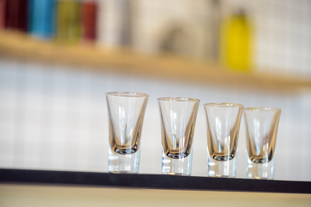 close-up view of empty glasses on bar counter