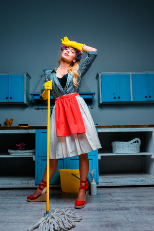 housewife mopping floor
