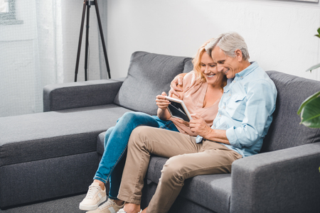 couple looking at photo frame
