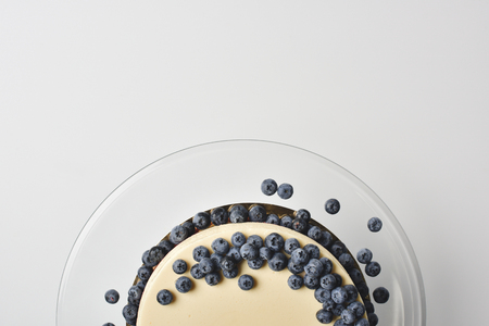cheesecake with blueberries on glass plate