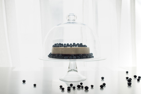 cheesecake with blueberries on glass stand Stock Photo - 86378644