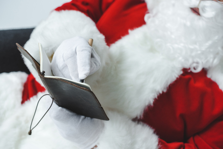 santa claus writing in notebook Stock Photo