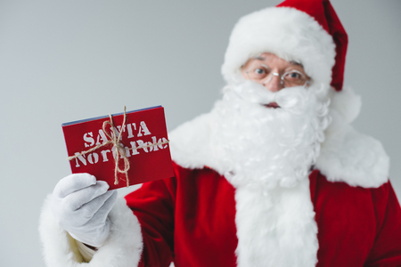 santa claus holding letters