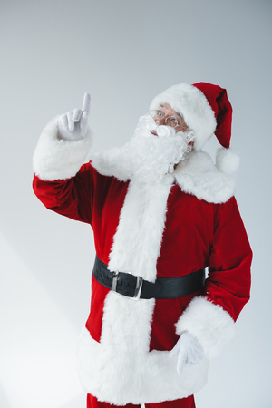 santa claus pointing with finger Stock Photo
