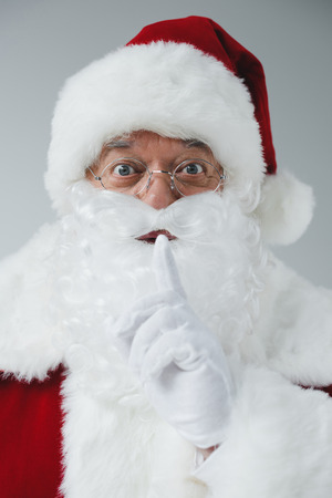 santa claus gesturing for silence