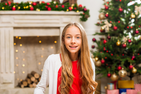 girl in christmas decorated room Stock Photo