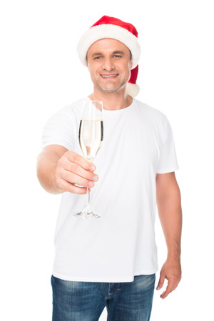 man in Santa hat with champagne Stock Photo