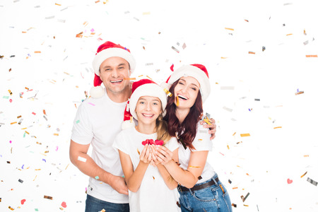 Happy family with Christmas confetti