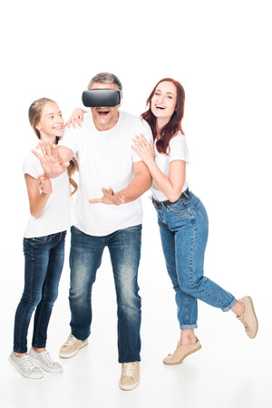 family using vr headset