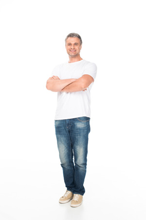 smiling man with crossed arms