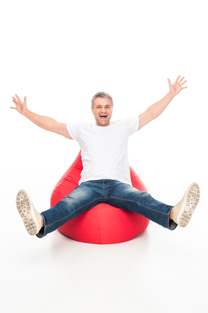 excited man on bean bag chair Stock Photo
