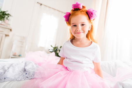 little girl with curlers and tutu tulle skirt