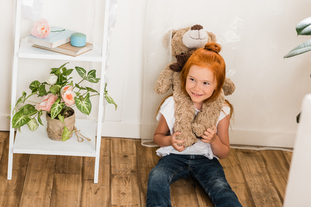 adorable little girl with teddy bear