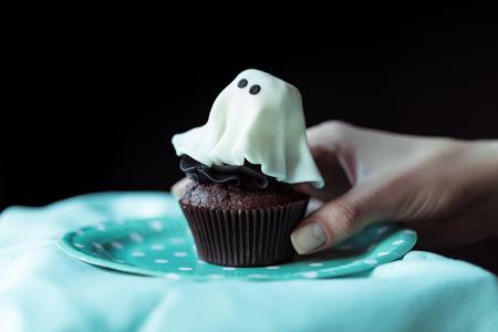 hand with halloween cupcake Stock Photo