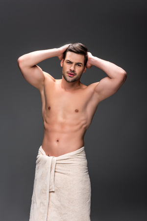 man covering with towel after shower Stockfoto