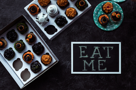 halloween cupcakes and eat me inscription Stock Photo