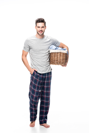 man with basket of laundry Stock Photo