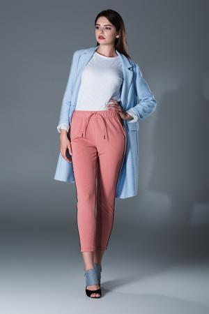 model posing in blue trench Stock Photo