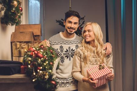 smiling couple on christmas eve Banco de Imagens