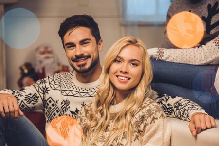 smiling couple on christmas eve Stock Photo