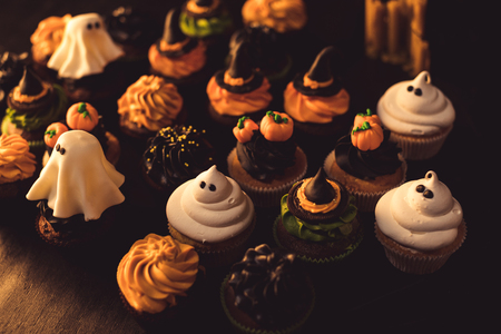 close-up view of various tasty homemade halloween cupcakes