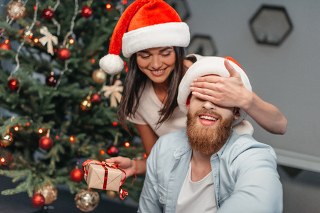 young couple with christmas present Stock Photo