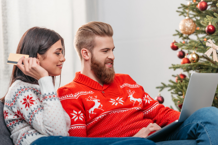 couple shopping online at christmas
