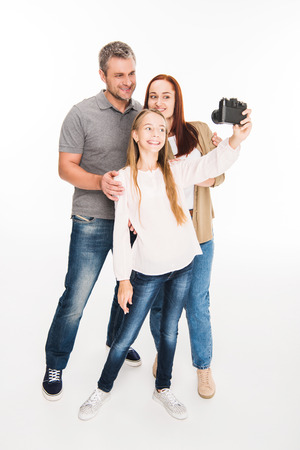 family taking selfie on camera