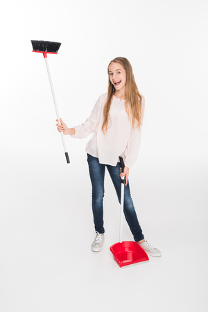 teen girl with broom