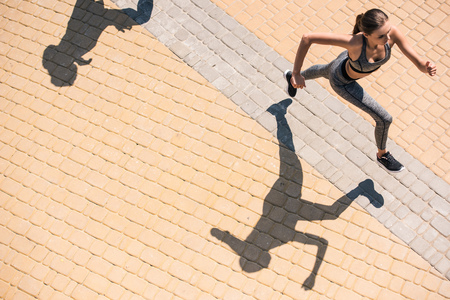 woman jogging on street