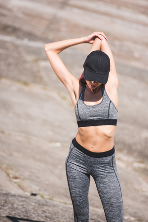 woman stretching on slabs Stock Photo