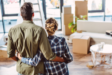 couple embracing in new house
