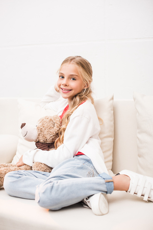 child with teddy bear