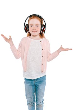 child listening music with headphones Stock Photo