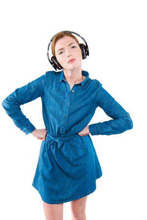 dissatisfied girl with headphones