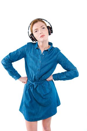 ontevreden meisje met een koptelefoon Stockfoto