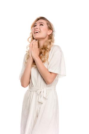 woman in robe praying