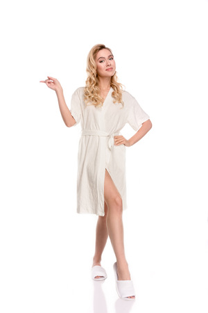 girl in robe pointing with finger Stock Photo