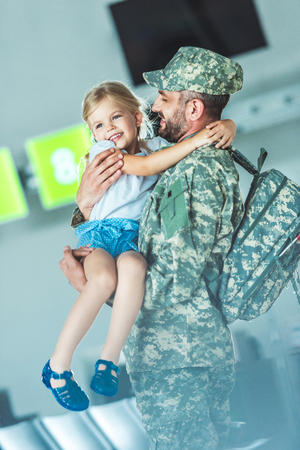 daughter meeting father at airport Stok Fotoğraf