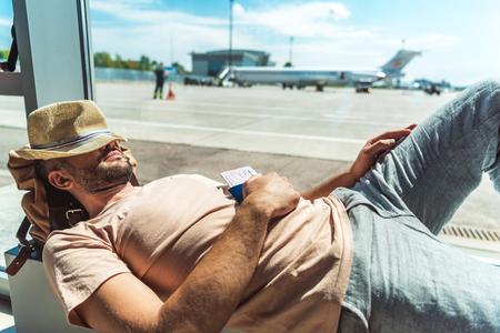 traveler sleeping in airport