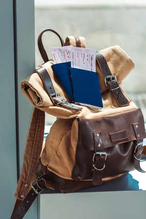 backpack, passports and tickets