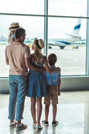 family looking out window in airport Stok Fotoğraf